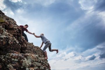 bigstock-Man-giving-helping-hand-to-fri-47765920